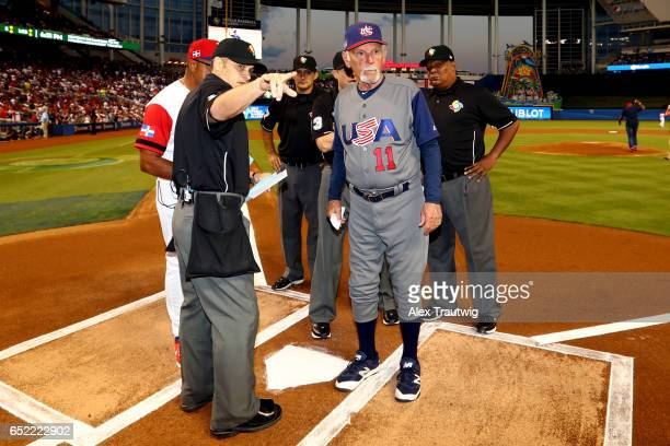Manager Jim Leyland goes over ground rules with home plate umpire Mark Wegner during Game 4 Pool C of the 2017 World Baseball Classic between Team...