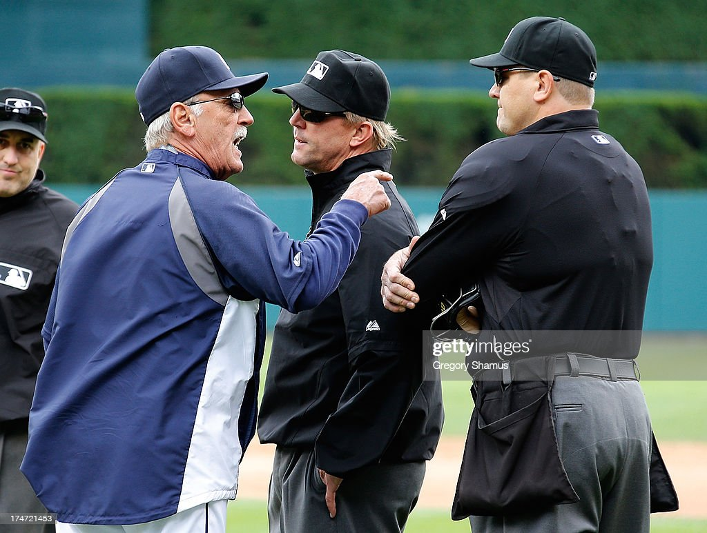 Manager <a gi-track='captionPersonalityLinkClicked' href=/galleries/search?phrase=Jim+Leyland&family=editorial&specificpeople=239038 ng-click='$event.stopPropagation()'>Jim Leyland</a> of the Detroit Tigers argues with first base umpire Jeff Kellogg after Miguel Cabrera #24 was ejected from the game by home plate umpire Chad Fisher (right) in the third inning while playing the Philadelphia Phillies at Comerica Park on July 28, 2013 in Detroit, Michigan. Leyland was also ejected.