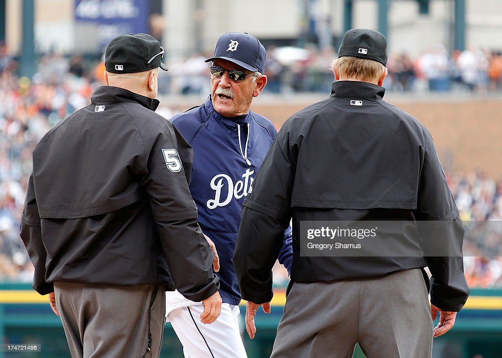 Manager <a gi-track='captionPersonalityLinkClicked' href=/galleries/search?phrase=Jim+Leyland&family=editorial&specificpeople=239038 ng-click='$event.stopPropagation()'>Jim Leyland</a> of the Detroit Tigers argues with second base umpire <a gi-track='captionPersonalityLinkClicked' href=/galleries/search?phrase=Eric+Cooper&family=editorial&specificpeople=239458 ng-click='$event.stopPropagation()'>Eric Cooper</a> (L) and first base umpire Jeff Kellogg after Miguel Cabrera #24 was ejected from the game in the third inning while playing the Philadelphia Phillies at Comerica Park on July 28, 2013 in Detroit, Michigan. Leyland was also ejected.
