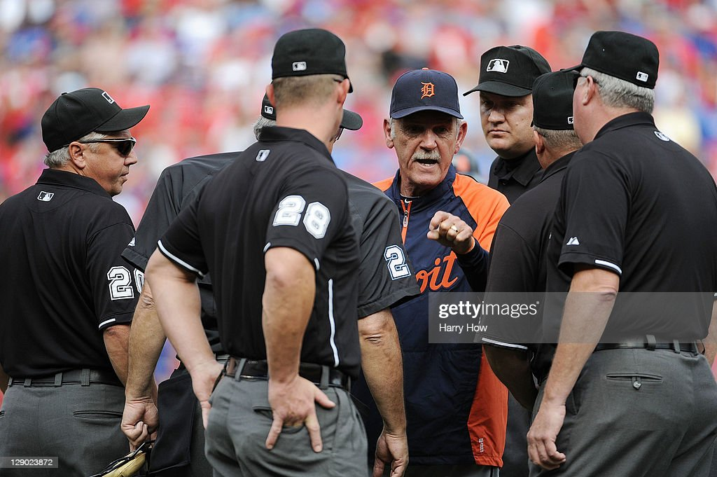 Manager Jim Leyland #10 of the Detroit Tigers argues with the umpires after a call was made that Victor Martinez #41 was hit by a pitch, taking away a run scored by Miguel Cabrera #24 in the third inning of Game Two of the American League Championship Series against the Texas Rangers at Rangers Ballpark in Arlington on October 10, 2011 in Arlington, Texas.