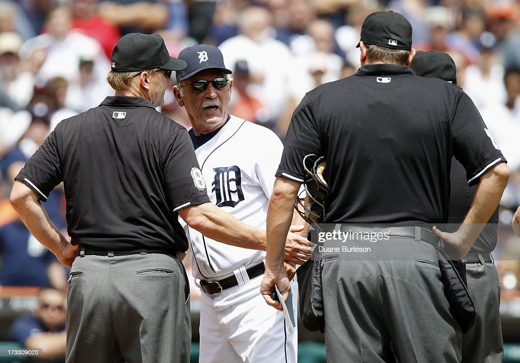 Manager <a gi-track='captionPersonalityLinkClicked' href=/galleries/search?phrase=Jim+Leyland&family=editorial&specificpeople=239038 ng-click='$event.stopPropagation()'>Jim Leyland</a> #10 of the Detroit Tigers argues with umpires Jeff Kellogg #8 (L) and Chad Fairchild after pitcher Luke Putkonen #36 of the Tigers was ejected for throwing at Alexei Ramirez #10 of the Chicago White Sox in the sixth inning at Comerica Park on July 11, 2013 in Detroit, Michigan.