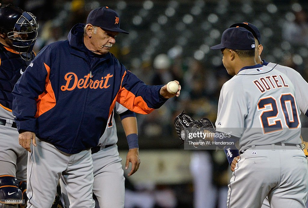 Manager <a gi-track='captionPersonalityLinkClicked' href=/galleries/search?phrase=Jim+Leyland&family=editorial&specificpeople=239038 ng-click='$event.stopPropagation()'>Jim Leyland</a> #10 of the Detroit Tigers hands the ball to relief pitcher <a gi-track='captionPersonalityLinkClicked' href=/galleries/search?phrase=Octavio+Dotel&family=editorial&specificpeople=169829 ng-click='$event.stopPropagation()'>Octavio Dotel</a> #20 against the Oakland Athletics in the ninth inning at O.co Coliseum on April 12, 2013 in Oakland, California.
