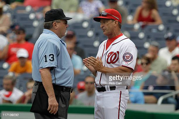 Manager Jim Riggleman of the Washington Nationals argues a call with home plate umpire Derryl Cousins during the first inning against the Seattle...