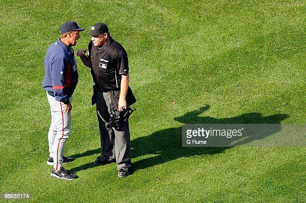 Manager Jim Riggleman of the Washington Nationals argues with home plate umpire Paul Schrieber after being ejected from the game against the...