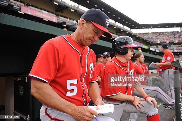 Manager Jim Riggleman of the Washington Nationals looks at his notes during a baseball game against the Baltimore Orioles on May 21 2011 at Orioles...