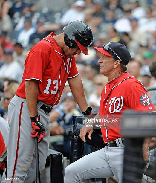 Manager Jim Riggleman of the Washington Nationals talks with Alex Cora during the ninth inning of a baseball game against San Diego Padres at Petco...