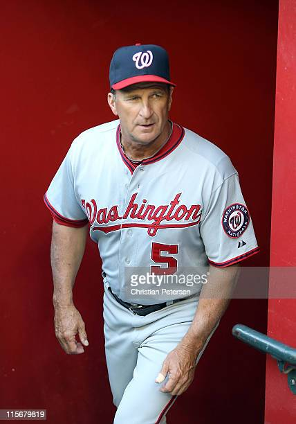 Manager Jim Riggleman of the Washington Nationals walks in the dugout during the Major League Baseball game against the Arizona Diamondbacks at Chase...