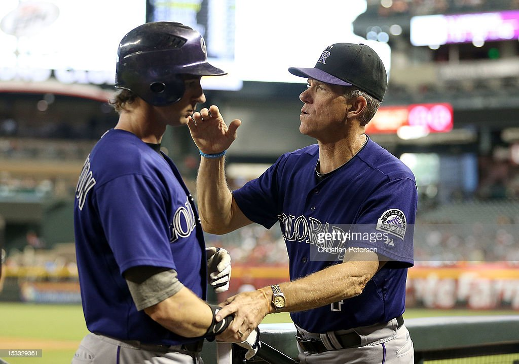 Manager Jim Tracy of the Colorado Rockies congratulates Charlie Blackmon #8 after he scored a fourth inning run against the Arizona Diamondbacks during the MLB game at Chase Field on October 3, 2012 in Phoenix, Arizona.