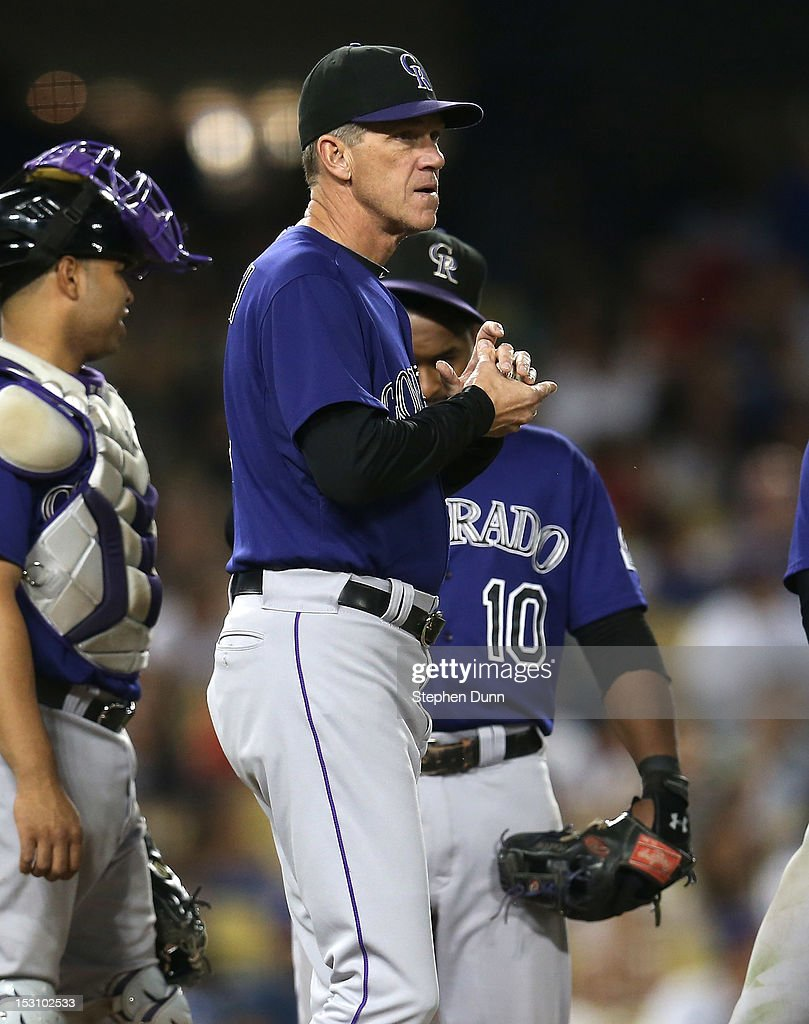 Manager <a gi-track='captionPersonalityLinkClicked' href=/galleries/search?phrase=Jim+Tracy&family=editorial&specificpeople=171518 ng-click='$event.stopPropagation()'>Jim Tracy</a> of the Colorado Rockies waits on the mound as he makes a pitching change in the sixth inning against the Los Angeles Dodgers on September 29, 2012 at Dodger Stadium in Los Angeles, California.