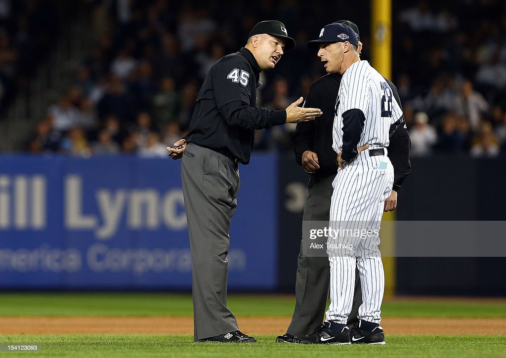 Manager Joe Girardi (R) of the New York Yankee argues with umpire Jeff Nelson after Nelson called Omar Infante (not pictured) #4 of the Detroit Tigers safe at second base on a play in the top of the eighth inning during Game Two of the American League Championship Series at Yankee Stadium on October 14, 2012 in the Bronx borough of New York City.