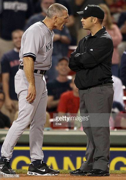 Manager Joe Girardi of the New York Yankees argues in the ninth inning with Mark Wegner after Jarrod Saltalamacchia of the Boston Red Sox was hit by...