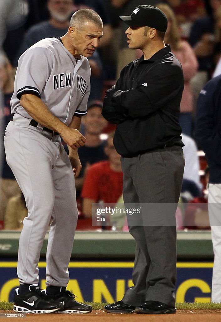 Manager <a gi-track='captionPersonalityLinkClicked' href=/galleries/search?phrase=Joe+Girardi&family=editorial&specificpeople=208659 ng-click='$event.stopPropagation()'>Joe Girardi</a> #28 of the New York Yankees argues in the ninth inning with <a gi-track='captionPersonalityLinkClicked' href=/galleries/search?phrase=Mark+Wegner&family=editorial&specificpeople=226706 ng-click='$event.stopPropagation()'>Mark Wegner</a> after Jarrod Saltalamacchia of the Boston Red Sox was hit by a pitch in the ninth inning on August 30, 2011 at Fenway Park in Boston, Massachusetts.