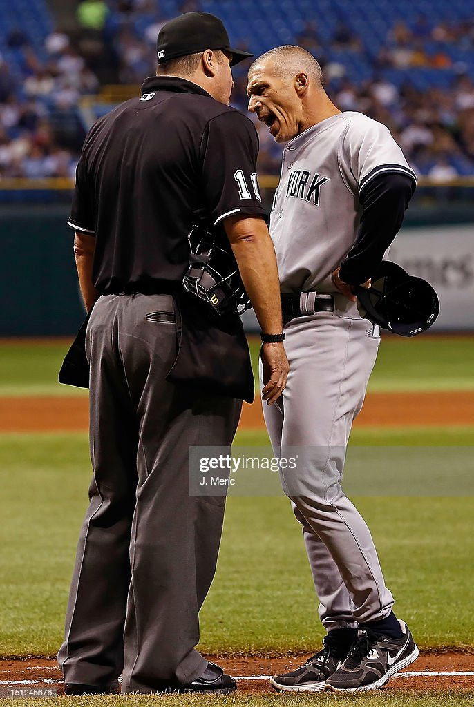 Manager Joe Girardi #28 of the New York Yankees argues with home plate umpire Tony Randazzo #11 after he is ejected against the Tampa Bay Rays during the game at Tropicana Field on September 4, 2012 in St. Petersburg, Florida.