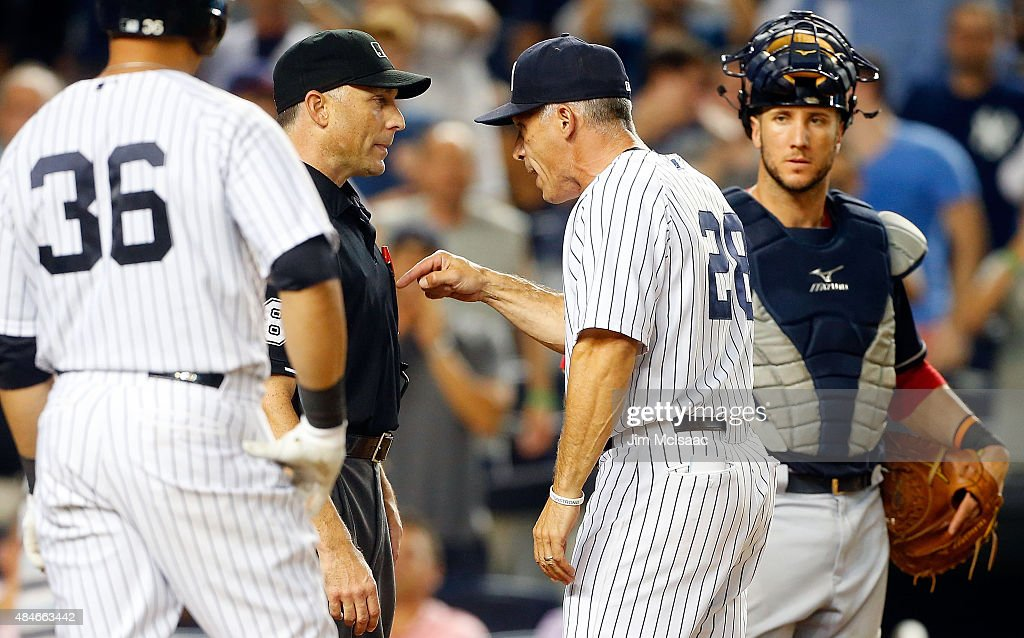 Manager <a gi-track='captionPersonalityLinkClicked' href=/galleries/search?phrase=Joe+Girardi&family=editorial&specificpeople=208659 ng-click='$event.stopPropagation()'>Joe Girardi</a> #28 of the New York Yankees argues with home plate umpire Dan Iassogna after he was ejected from a game against the Cleveland Indians in the ninth inning at Yankee Stadium on August 20, 2015 in the Bronx borough of New York City.