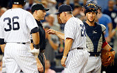 Manager Joe Girardi of the New York Yankees argues with home plate umpire Dan Iassogna after he was ejected from a game against the Cleveland Indians...
