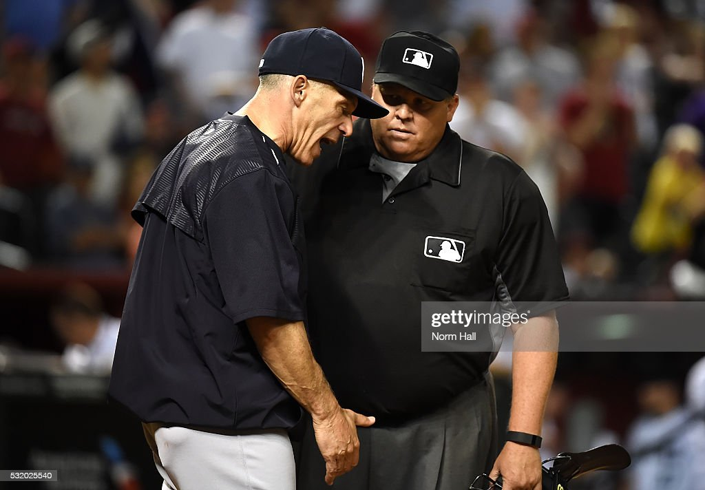 Manager <a gi-track='captionPersonalityLinkClicked' href=/galleries/search?phrase=Joe+Girardi&family=editorial&specificpeople=208659 ng-click='$event.stopPropagation()'>Joe Girardi</a> #28 of the New York Yankees argues with home plate umpire Fieldin Culbreth #25 after Brett Gardner #11 was called out on strikes against the Arizona Diamondbacks during the eighth inning at Chase Field on May 17, 2016 in Phoenix, Arizona.