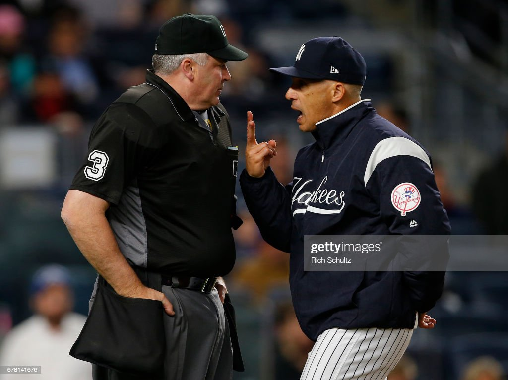 Manager Joe Girardi #28 of the New York Yankees argues with home plate umpire Bill Welke #3 after being thrown out of the game in the seventh inning against the Toronto Blue Jays during a game at Yankee Stadium on May 3, 2017 in New York City.