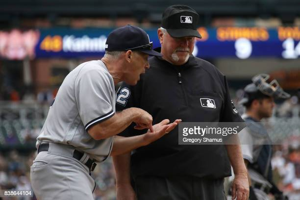 Manager Joe Girardi of the New York Yankees argues with umpire Dana DeMuth in the sixth inning while playing the Detroit Tigers at Comerica Park on...