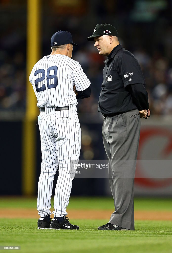 Manager Joe Girardi of the New York Yankees argues with umpire Jeff Nelson against the Detroit Tigers during Game Two of the American League Championship Series at Yankee Stadium on October 14, 2012 in the Bronx borough of New York City.