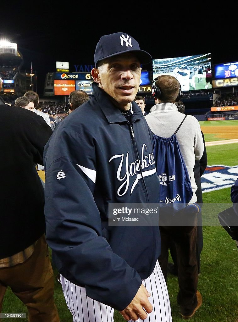 Manager Joe Girardi of the New York Yankees celebrates after defeating the Baltimore Orioles in Game Five of the American League Division Series at Yankee Stadium on October 12, 2012 in the Bronx borough of New York City. The Yankees defeated the Orioles 3-1 to win their best of five series three games to two.