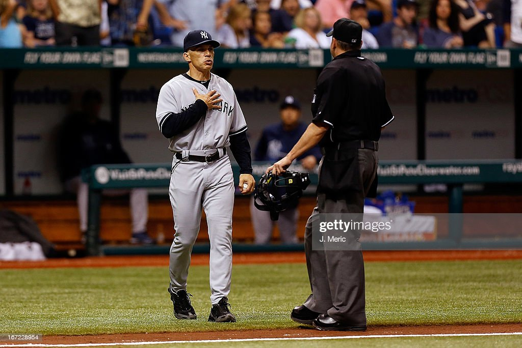 Manager Joe Girardi #28 of the New York Yankees comes out of the dugout for an explanation from homeplate umpire Andy Fletcher during the game against the Tampa Bay Rays at Tropicana Field on April 22, 2013 in St. Petersburg, Florida.