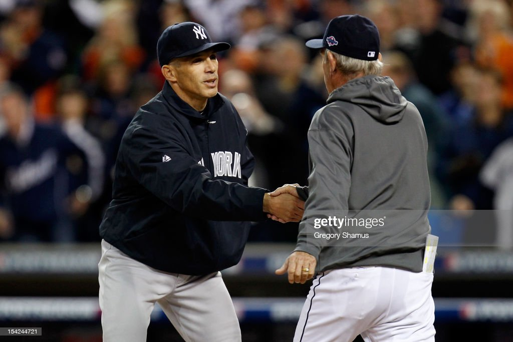 Manager Joe Girardi of the New York Yankees greets manager Jim Leyland of the Detroit Tigers during pregame festivities prior to game three of the American League Championship Series at Comerica Park on October 16, 2012 in Detroit, Michigan.
