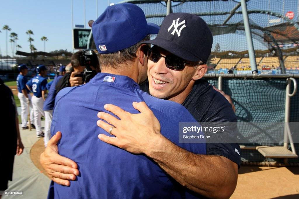 Manager <a gi-track='captionPersonalityLinkClicked' href=/galleries/search?phrase=Joe+Girardi&family=editorial&specificpeople=208659 ng-click='$event.stopPropagation()'>Joe Girardi</a> of the New York Yankees hugs manager <a gi-track='captionPersonalityLinkClicked' href=/galleries/search?phrase=Joe+Torre&family=editorial&specificpeople=204583 ng-click='$event.stopPropagation()'>Joe Torre</a> of the Los Angeles Dodgers before their game on June 25, 2010 at Dodger Stadium in Los Angeles, California.