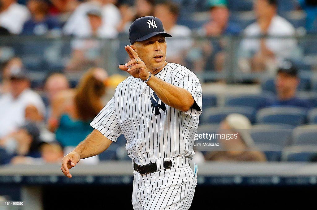 Manager <a gi-track='captionPersonalityLinkClicked' href=/galleries/search?phrase=Joe+Girardi&family=editorial&specificpeople=208659 ng-click='$event.stopPropagation()'>Joe Girardi</a> #28 of the New York Yankees in action against the Toronto Blue Jays at Yankee Stadium on August 22, 2013 in the Bronx borough of New York City. The Yankees defeated the Blue Jays 5-3.