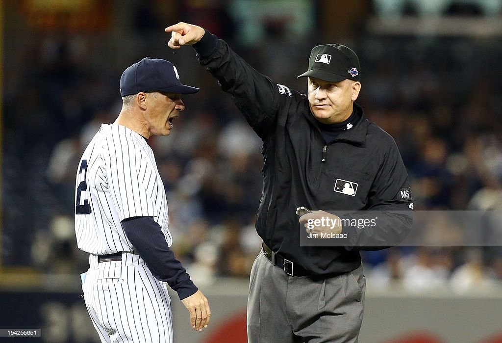 Manager Joe Girardi #28 of the New York Yankees is thrown out out of Game Two of the American League Championship Series in the eighth inning against the Detroit Tigers by second nase umpire Jeff Nelson at Yankee Stadium on October 14, 2012 in the Bronx borough of New York City, New York.. The Tigers defeated the Yankees 3-0.