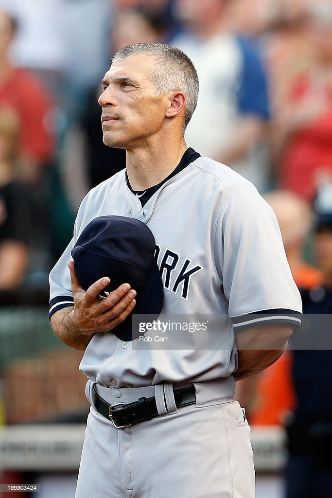 Manager Joe Girardi of the New York Yankees listens to the national anthem before the start of the Yankees 6-3 loss to the Baltimore Orioles at Oriole Park at Camden Yards on May 22, 2013 in Baltimore, Maryland.