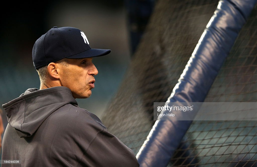 Manager Joe Girardi of the New York Yankees looks on during batting practice against the Detroit Tigers during game three of the American League Championship Series at Comerica Park on October 16, 2012 in Detroit, Michigan.