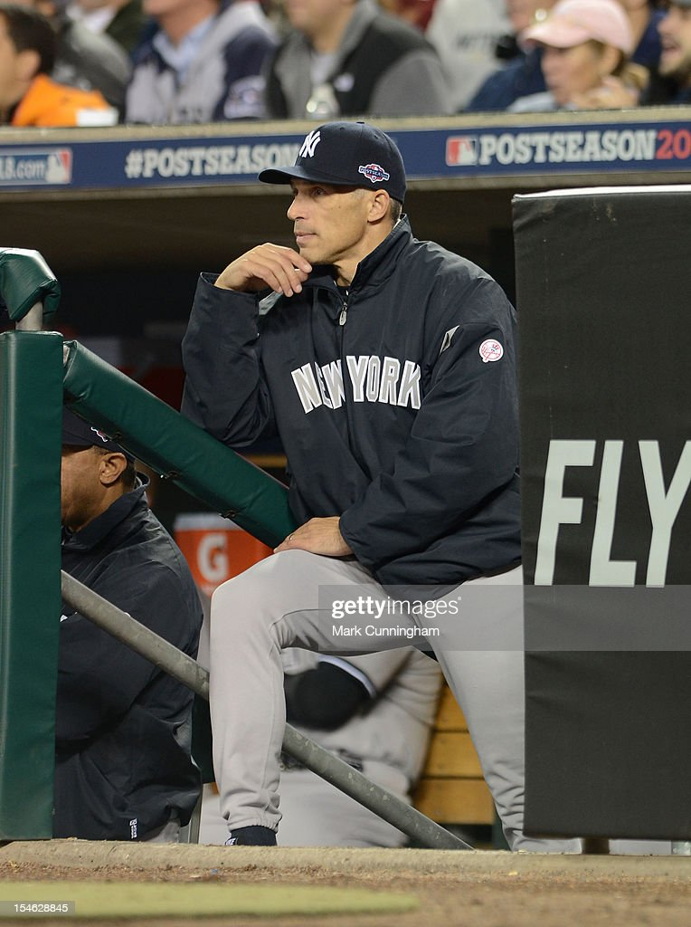 Manager Joe Girardi #28 of the New York Yankees looks on from the dugout steps during Game Three of the American League Championship Series against the Detroit Tigers at Comerica Park on October 16, 2012 in Detroit, Michigan. The Tigers defeated the Yankees 2-1.