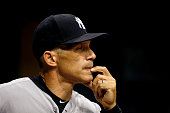 Manager Joe Girardi of the New York Yankees looks on from the dugout during the second inning of a game against the Tampa Bay Rays on September 14...