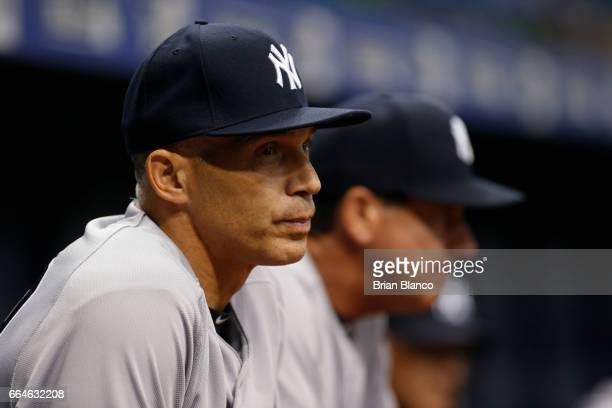Manager Joe Girardi of the New York Yankees looks on from the dugout during the first inning of a game against the Tampa Bay Rays on April 4 2017 at...
