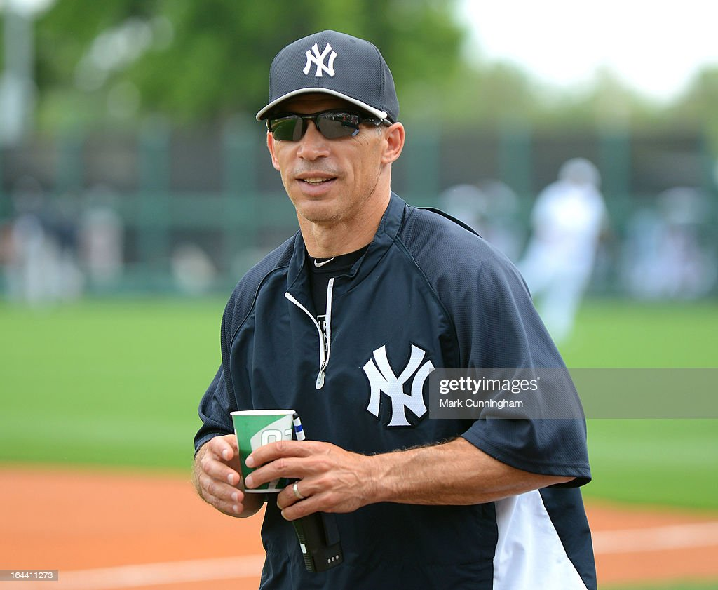 Manager Joe Girardi #28 of the New York Yankees looks on prior to the spring training game against the Detroit Tigers at Joker Marchant Stadium on March 23, 2013 in Lakeland, Florida. The Tigers defeated the Yankees 10-6.