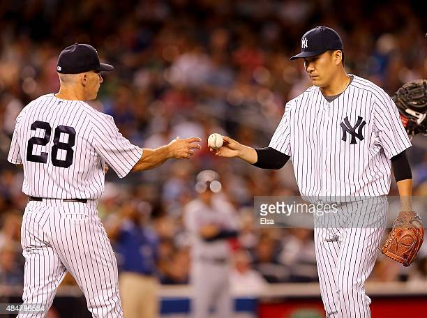 Manager Joe Girardi of the New York Yankees pulls Masahiro Tanaka in the seventh inning against the Cleveland Indians on August 21 2015 at Yankee...