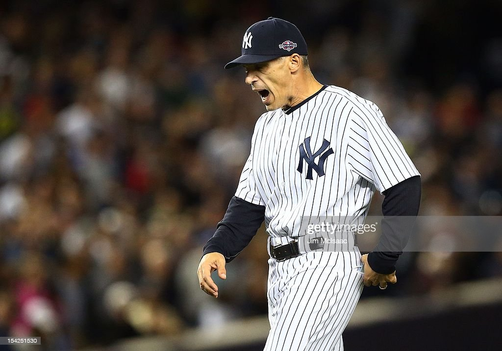 Manager Joe Girardi #28 of the New York Yankees reacts in the eighth inning against the Detroit Tigers during Game Two of the American League Championship Series at Yankee Stadium on October 14, 2012 in the Bronx borough of New York City, New York.. The Tigers defeated the Yankees 3-0.