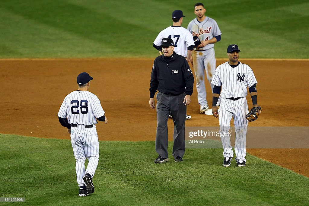 Manager Joe Girardi #28 of the New York Yankees runs out to argue with umpire Jeff Nelson after Nelson called Omar Infante #4 of the Detroit Tigers safe at second base on a play in the top of the eighth inning during Game Two of the American League Championship Series at Yankee Stadium on October 14, 2012 in the Bronx borough of New York City.