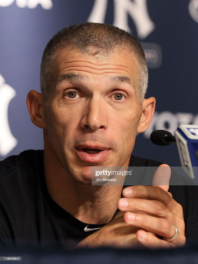 Manager Joe Girardi of the New York Yankees speaks to the media after the game against the Tampa Bay Rays was postponed due to rain on July 8, 2011 at Yankee Stadium in the Bronx borough of New York City.