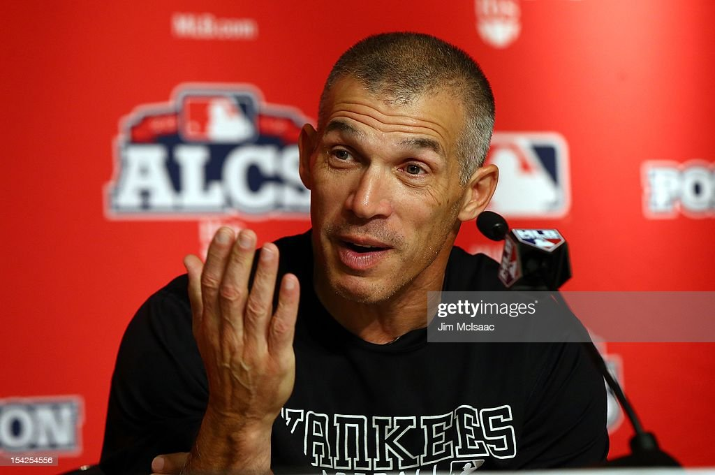 Manager Joe Girardi #28 of the New York Yankees speaks to the media before Game Two of the American League Championship Series against the Detroit Tigers at Yankee Stadium on October 14, 2012 in the Bronx borough of New York City, New York.. The Tigers defeated the Yankees 3-0.