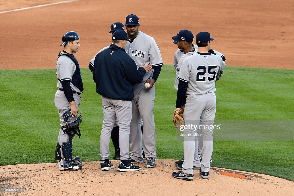 Manager Joe Girardi of the New York Yankees takes starting pitcher CC Sabathia #52 out of the game in the bottom of the fourht inning against the Detroit Tigers uring game four of the American League Championship Series at Comerica Park on October 18, 2012 in Detroit, Michigan.