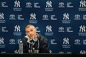 Manager Joe Girardi of the New York Yankees talks with the media during spring training media availability at George M Steinbrenner Field on February...