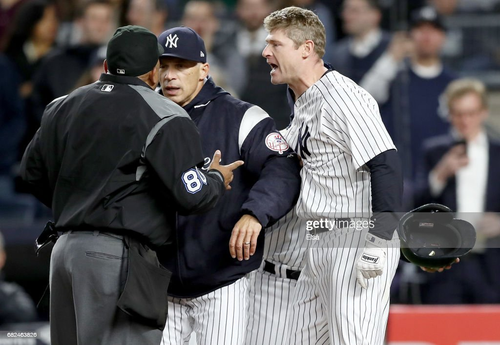 Manager Joe Girardi #28 of the New York Yankees tries to separate home plate umpire Adrian Johnson #80 and Chase Headley #12 in the seventh inning against the Houston Astros on May 12, 2017 at Yankee Stadium in the Bronx borough of New York City.Headley was thrown out of the game after the altercation.
