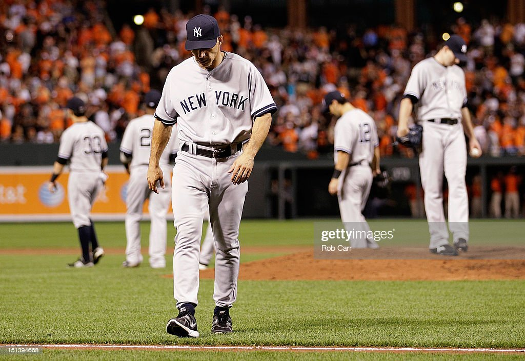 Manager <a gi-track='captionPersonalityLinkClicked' href=/galleries/search?phrase=Joe+Girardi&family=editorial&specificpeople=208659 ng-click='$event.stopPropagation()'>Joe Girardi</a> of the New York Yankees walks back to the dugout after making a pitching change against the Baltimore Orioles during the eighth inning of the Yankees 10-6 loss at Oriole Park at Camden Yards on September 6, 2012 in Baltimore, Maryland.
