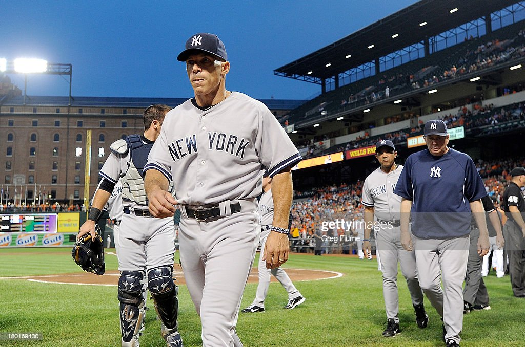 Manager <a gi-track='captionPersonalityLinkClicked' href=/galleries/search?phrase=Joe+Girardi&family=editorial&specificpeople=208659 ng-click='$event.stopPropagation()'>Joe Girardi</a> #28 of the New York Yankees walks to the dugout in the first inning of the game after an altercation with the Baltimore Orioles at Oriole Park at Camden Yards on September 9, 2013 in Baltimore, Maryland.