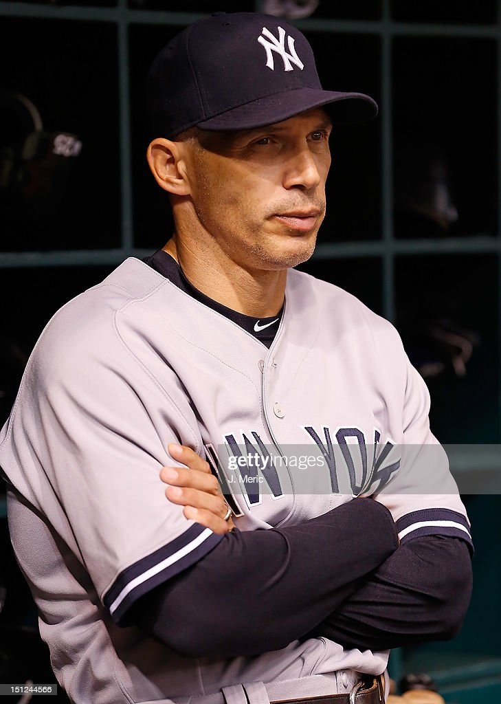 Manager <a gi-track='captionPersonalityLinkClicked' href=/galleries/search?phrase=Joe+Girardi&family=editorial&specificpeople=208659 ng-click='$event.stopPropagation()'>Joe Girardi</a> #28 of the New York Yankees watches his team against the Tampa Bay Rays during the game at Tropicana Field on September 4, 2012 in St. Petersburg, Florida.