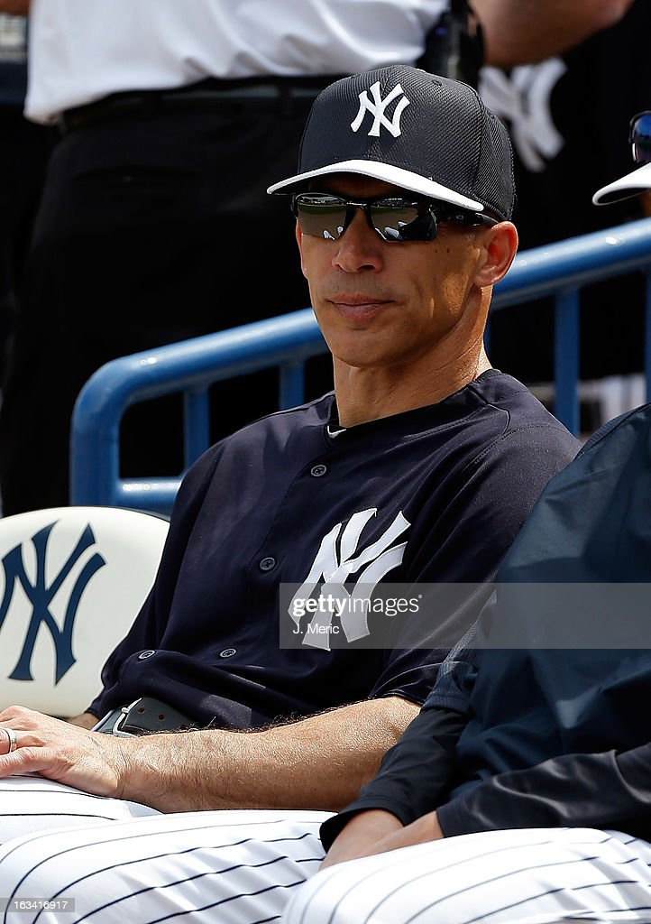 Manager Joe Girardi #28 of the New York Yankees watches his team against the Atlanta Braves during a Grapefruit League Spring Training Game at George M. Steinbrenner Field on March 9, 2013 in Tampa, Florida.