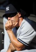 Manager Joe Girardi of the New York Yankees watches the action from the dugout during the game against the Los Angeles Dodgers on June 26 2010 at...