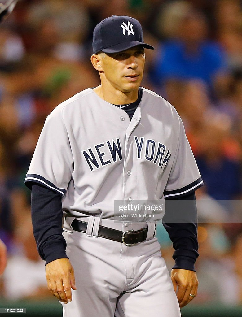 Manager Joe Girardi #28 walks to the mound before pulling CC Sabathia #52 of the New York Yankees from the game in the sixth inning against the Boston Red Sox during the game on July 21, 2013 at Fenway Park in Boston, Massachusetts.