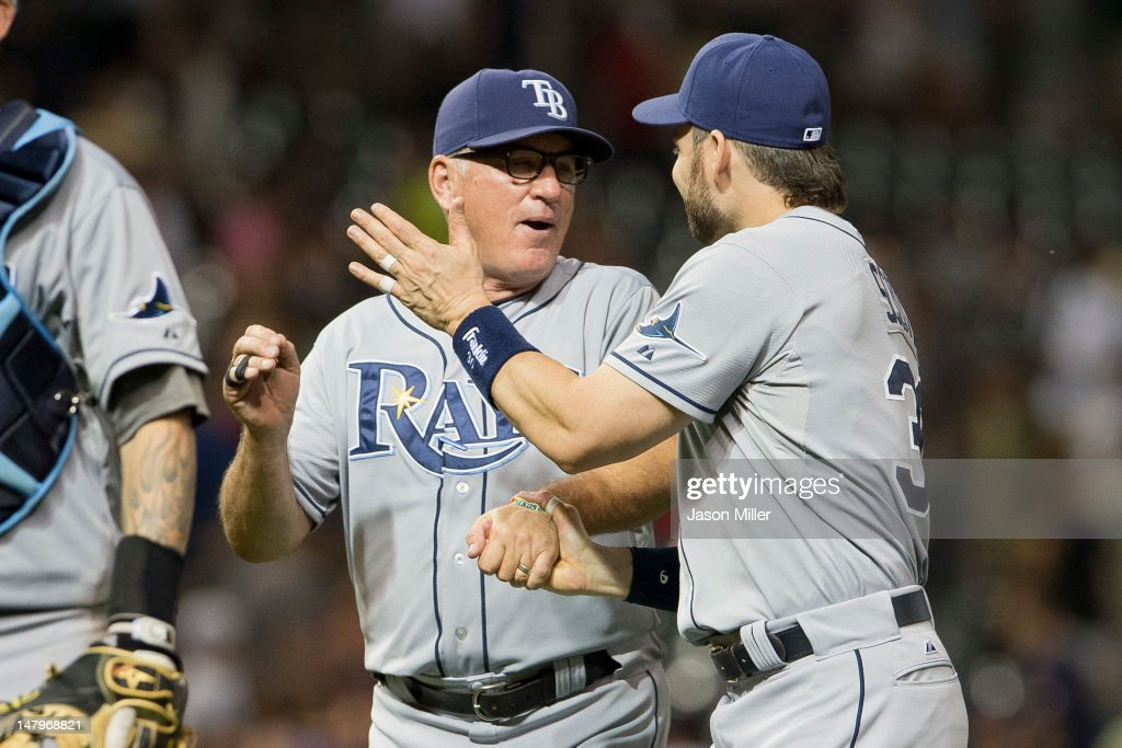 Manager <a gi-track='captionPersonalityLinkClicked' href=/galleries/search?phrase=Joe+Maddon&family=editorial&specificpeople=568433 ng-click='$event.stopPropagation()'>Joe Maddon</a> #70 celebrates with <a gi-track='captionPersonalityLinkClicked' href=/galleries/search?phrase=Luke+Scott&family=editorial&specificpeople=757156 ng-click='$event.stopPropagation()'>Luke Scott</a> #30 of the Tampa Bay Rays after defeating the Cleveland Indians at Progressive Field on July 6, 2012 in Cleveland, Ohio. The Rays defeated the Indians 10-3.